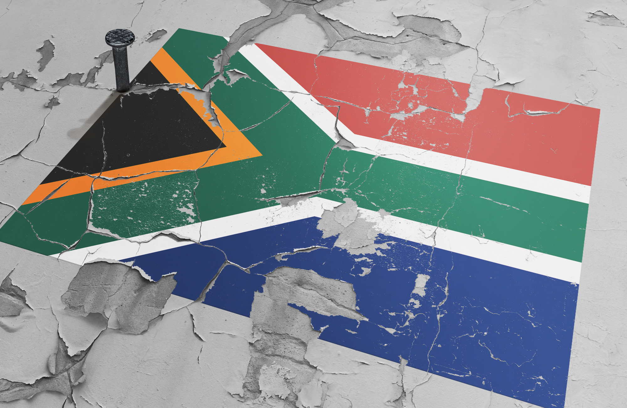 According to South Africans, what [still] divides us?